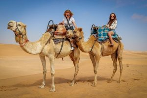 Women riding camels in Egypt
